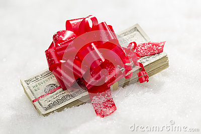 Wrapped Stack of Hundred Dollar Bills with Red Ribbon on Snow