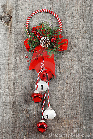 Wreath and bells hanging on old wood
