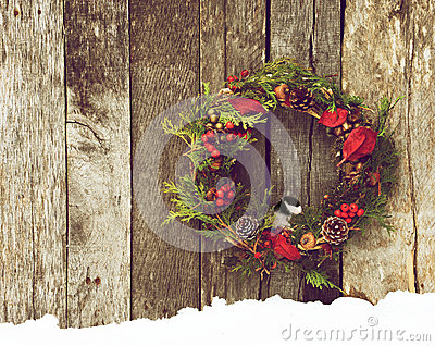 Wreath with Chickadee peeking out.