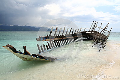 Wreck of the boat on the beach Stock Photo