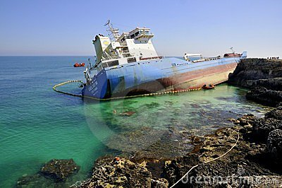 Wrecked oil tanker in clean sea water Editorial Stock Photo
