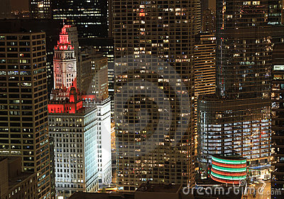 Wrigley Building washed in red lights at night Editorial Image