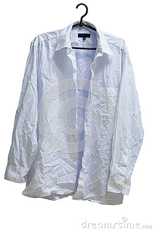 Wrinkled male white laundered shirt on hanger