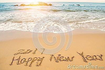 Write happy new year 2017 on beach Stock Photo