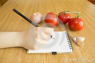 Write in Notebook and Fresh Vegetables