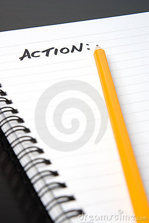 Writing ACTION In A Spiral-bound Notebook. Royalty Free Stock Photo - Image: 7874075