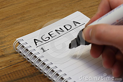 Agenda in spiral bound notebook