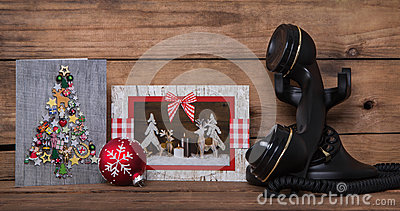 Writing or calling friends on christmas time. Wooden background Stock Photo