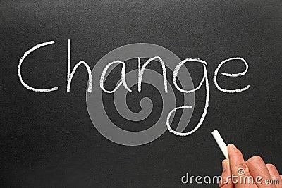 Writing change on a blackboard.