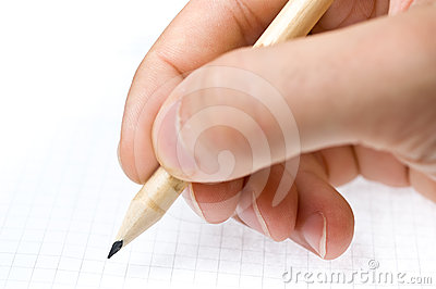 Writing. An hand who writes in a paper sheet