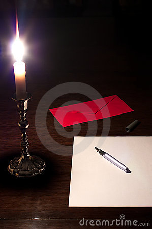 Writing a letter by the candlelight