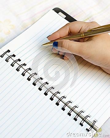 Free Writing On Notepad Stock Image - 26191411