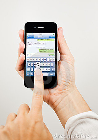 Writing a text message on iPhone 4 Editorial Image