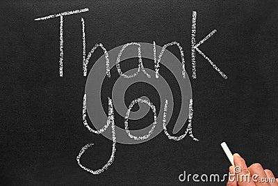 Writing thank you on a blackboard.