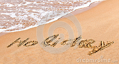 Written holiday drawn on the sand