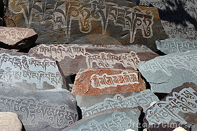 written mantra on buddhist mani stones