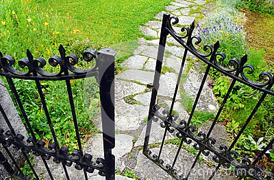 Wrought iron gate, garden stone path