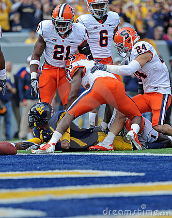 WVU football player stretches trying for a TD Editorial Image