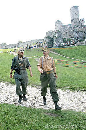 WWII Soldiers and Ogrodzieniecki Castle Editorial Photo