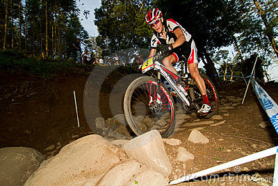 XCO rider in rocky section at UCI MTB World Cup Editorial Photo