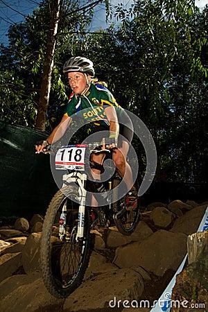 XCO Woman riding down Rock Garden section Editorial Photo