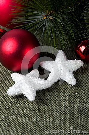 Xmas baubles on green canvas background