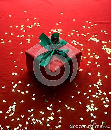 Xmas gift over golden stars
