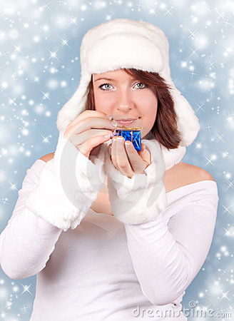 Xmas girl opening a gift with snowflakes