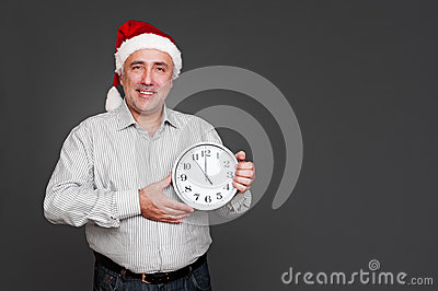 Xmas man showing the clock