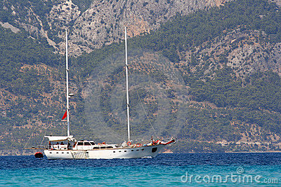 Yacht against mountainous Turkish coast