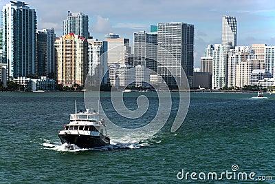 Yacht and city coast