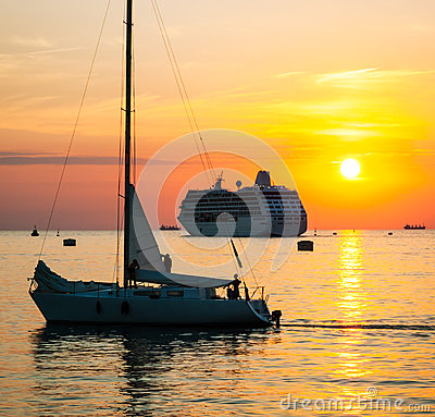 Yacht and cruise ship at sunset