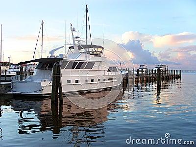 Yacht at dawn at dock