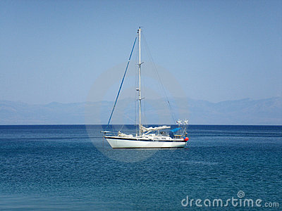 Yacht in light blue aegean sea