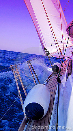 Yacht sailing in blue sea
