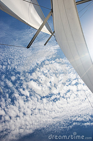 Yacht sails, cloudy sky