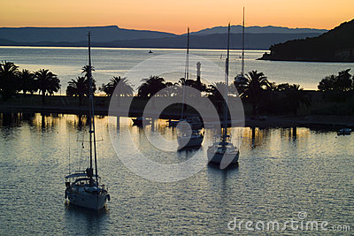 Yachts in bay of Vis town at sunrise