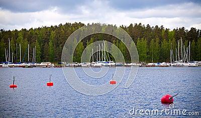 Yachts moorings buoys in small European marina