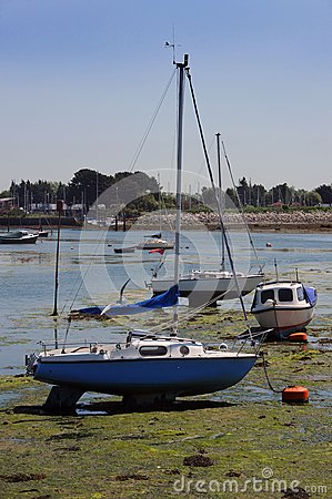 Yachts on the mud at low tide.