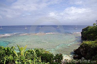Yachts off tropical island