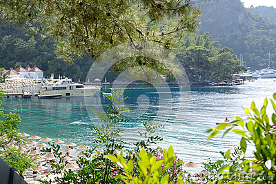 Yachts at the pier and beach on Mediterranean turkish resort
