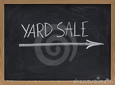 Yard sale sign on blackboard