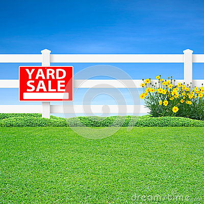 Yard sale sign and fence