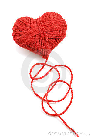 Yarn of wool in heart shape symbol