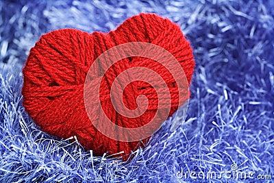 Yarn of wool in heart shape symbol