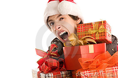 Yawning christmas boy holding gifts