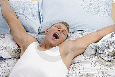 Yawning man stretching his arms