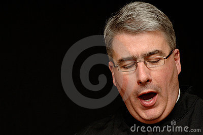 Yawning priest
