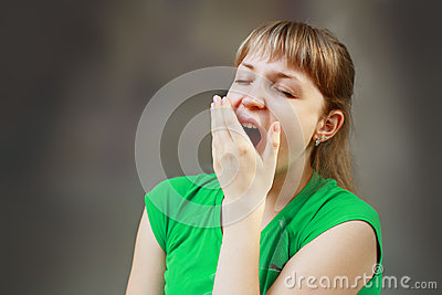 Yawning tired woman