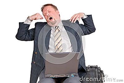 Yawning traveling businessman